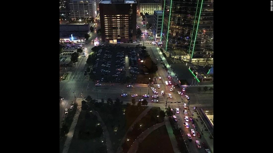 "A view of downtown Dallas after the shootings. Kent Giles captured the image and told CNN he ""heard multiple shots being fired. Probably more than 20 rounds. This is the intersection of Main and Griffin looking towards the west."""