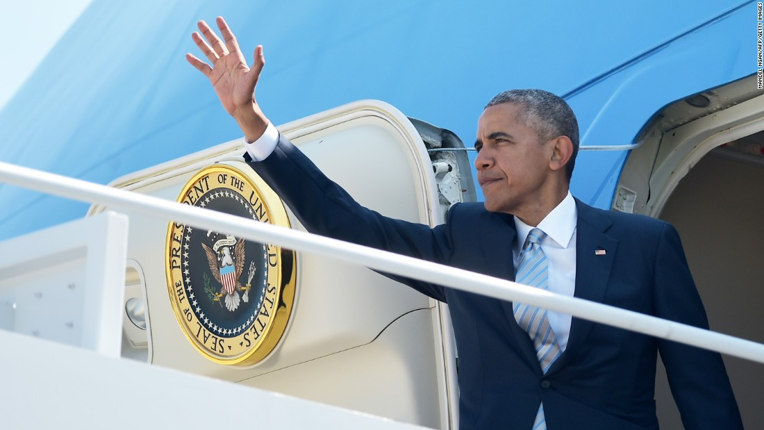 Obama boards Air Force One at Andrews Air Force Base before departing for Warsaw, Poland, on Thursday, July 7.