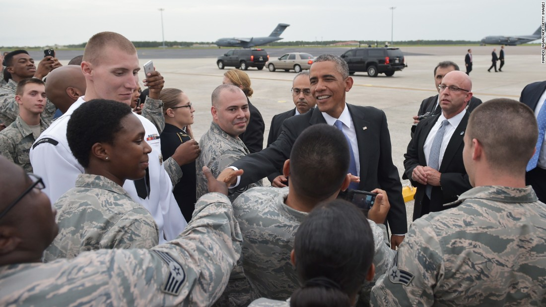 US President Barack Obama greets military personnel upon arrival at MacDill Air Force Base in Tampa, Florida, on September 16, 2014.