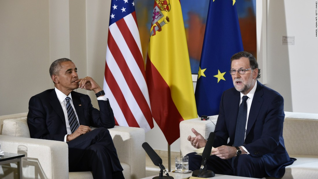 Obama talks with Spanish interim Prime Minister Mariano Rajoy during a bilateral meeting at Moncloa Palace in Madrid on July 10.