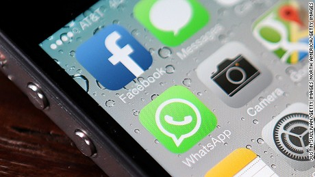 SAN FRANCISCO, CA - FEBRUARY 19:  The Facebook and WhatsApp app icons are displayed on an iPhone on February 19, 2014 in San Francisco City. Facebook Inc. announced that it will purchase smartphone-messaging app company WhatsApp Inc. for $19 billion in cash and stock.  (Photo illustration by Justin Sullivan/Getty Images)