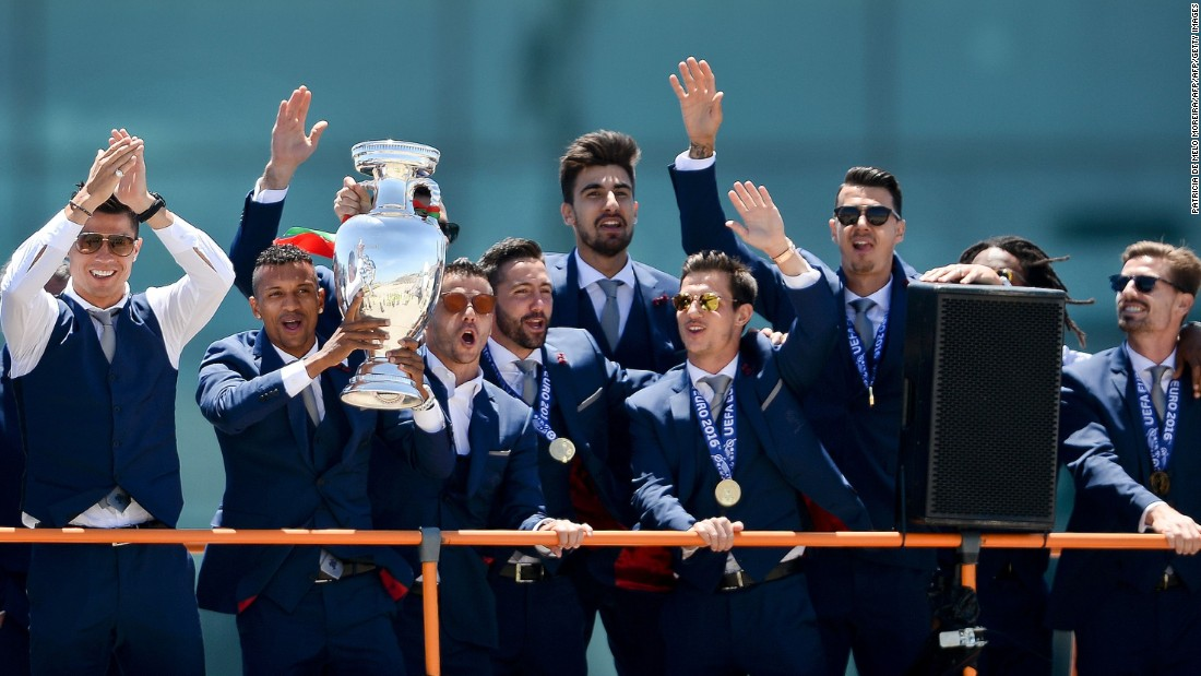 An open-top bus paraded the stars through the streets of Lisbon as the players showed off the trophy -- the nation's first at a major football tournament, and some consolation after losing the 2004 final on home soil.