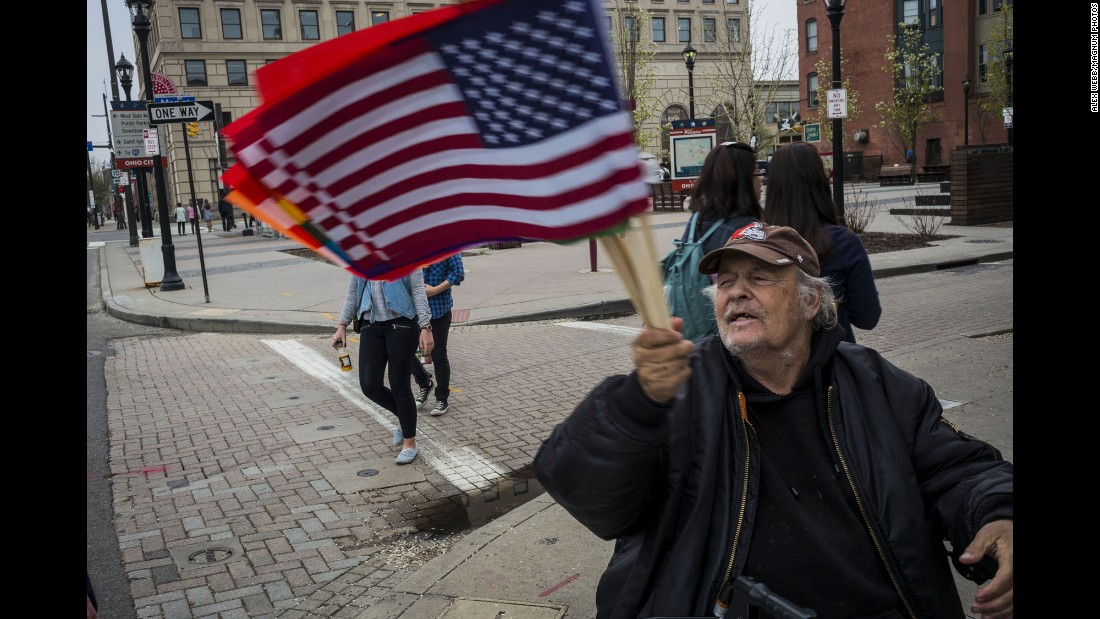 A man sells American flags in Ohio City, a Cleveland neighborhood just west of downtown and the Cuyahoga River.