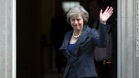 LONDON, ENGLAND - JULY 12: Prime Minister-in-waiting, Theresa May waves as she arrives for a Cabinet meeting at Downing Street on July 12, 2016 in London, England. David Cameron will step aside tomorrow, Wednesday 13, after his final Prime Minister's Questions allowing current Home Secretary Theresa May to move into 10 Downing Street.  She was selected unopposed by Conservative MPs to be their new leader.  (Photo by Carl Court/Getty Images)