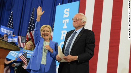 Presumptive Democratic presidential nominee Hillary Clinton and Bernie Sanders take the stage at Portsmouth High School July 12, 2016 in Portsmouth, New Hampshire. Sanders endorsed Clinton for president of the United States.