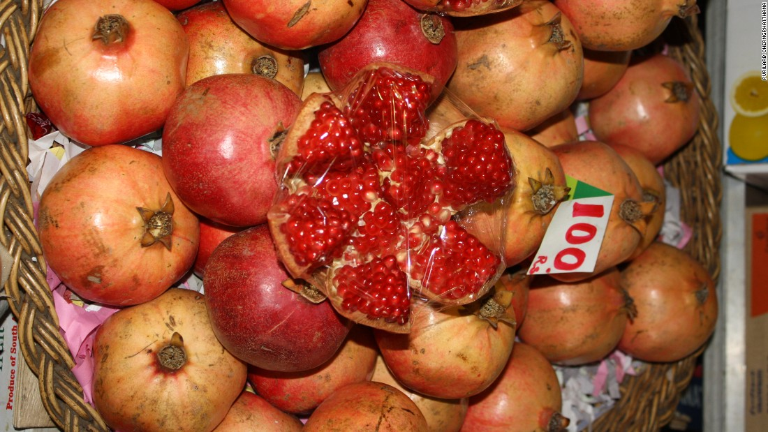 As a country's income goes up, people are in theory able to buy more healthy foods. <br />Pictured here, pomegranates at a market in Mauritius.
