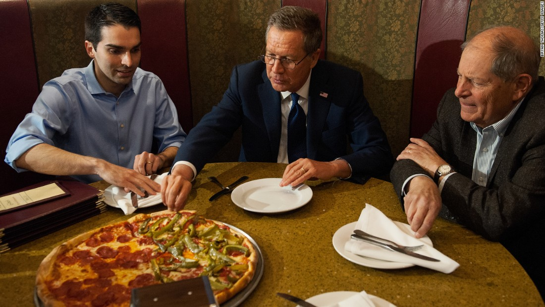 New York City Council member Eric Ulrich (left) joined then-Republican presidential candidate John Kasich (center) and former New York Rep. Bob Turner at Gino's Pizzeria and Restaurant on March 30, 2016, in Queens, New York. <br />