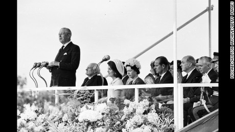 Harold Macmillan gives a speech at the inauguration ceremony of a memorial to John F Kennedy.