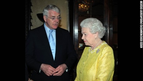 The Queen speaks with former Prime Minister John Major on March 12, 2012 in London.