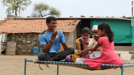 Bokhanal sits with his nieces and grandfather. He says he competes to support his family.