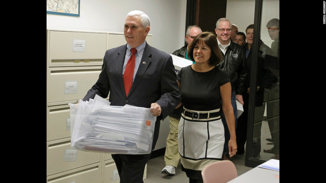 Pence is joined by his wife, Karen, as he carries his ballot petition signatures to run for governor of Indiana into the Secretary of State's Election Division in Indianapolis on February 6, 2012.