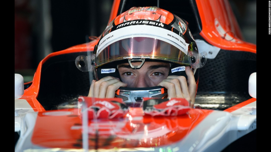 Bianchi puts on his helmet in the pits during the first practice session ahead of the German GP at the Hockenheimring in Hockenheim, Germany on July  18, 2014.