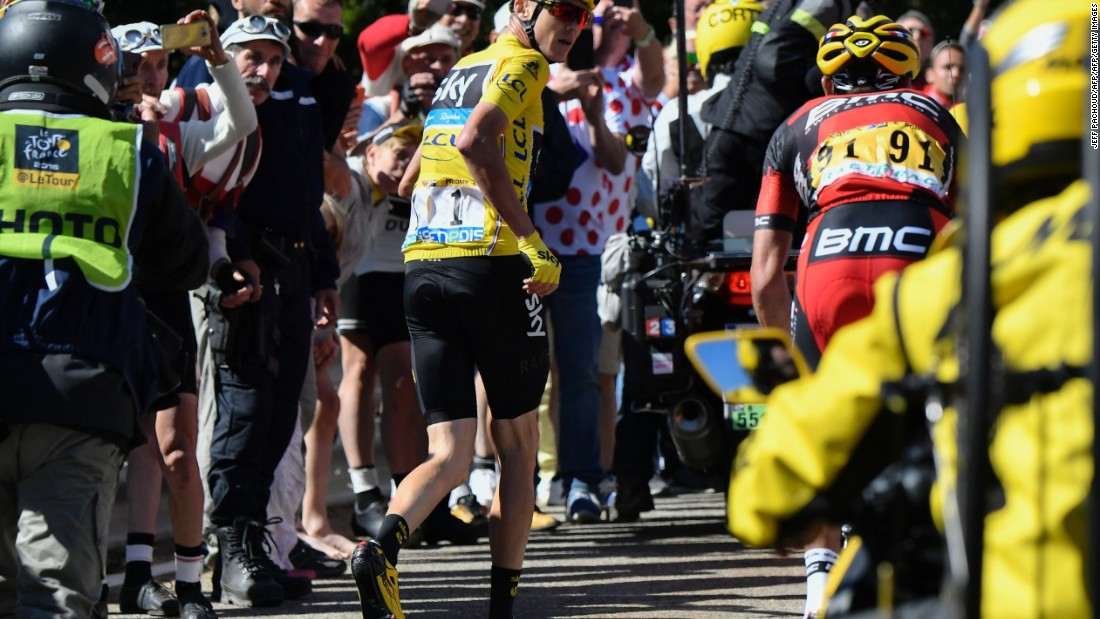 Froome runs to get another bike after falling during the 178 kilometer 12th stage of the 103rd edition of the Tour de France cycling race on July 14, 2016 between Montpellier and Chalet-Reynard.