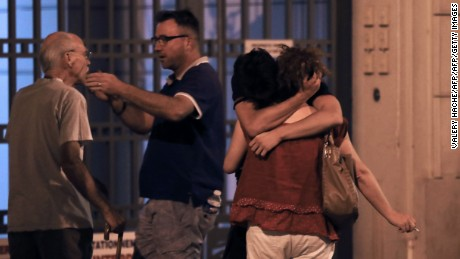 People in the French towon of Nice comfort each other after an attack taht killed at least 84 people.