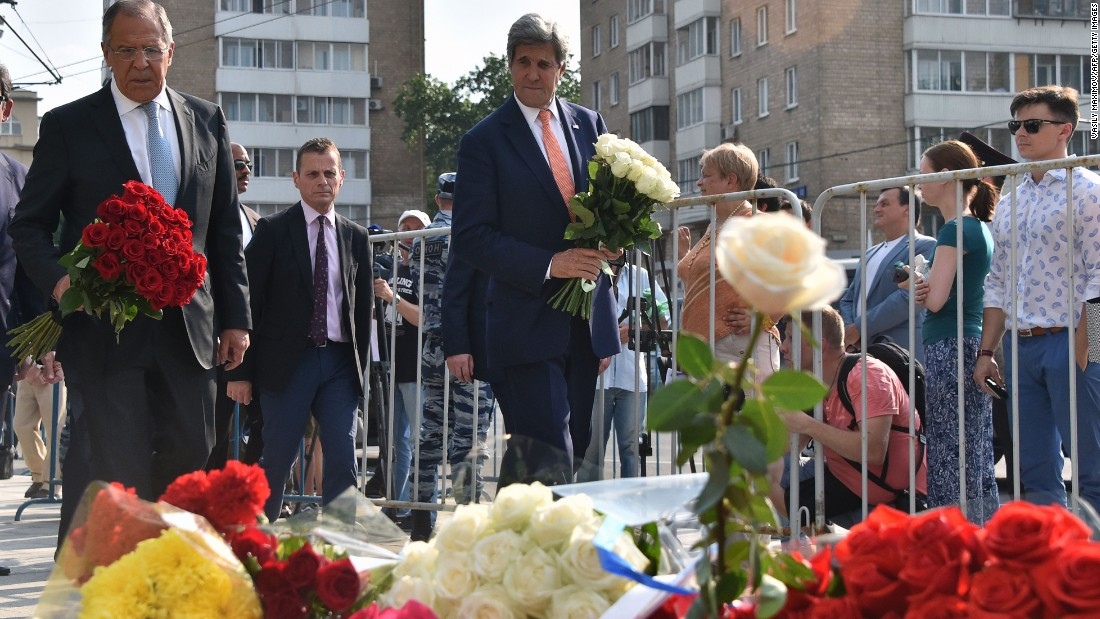 Russian Foreign Minister Sergei Lavrov and U.S. Secretary of State John Kerry lay flowers outside the French Embassy in Moscow.