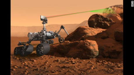 This illustration shows the SuperCam instrument in action on Mars.