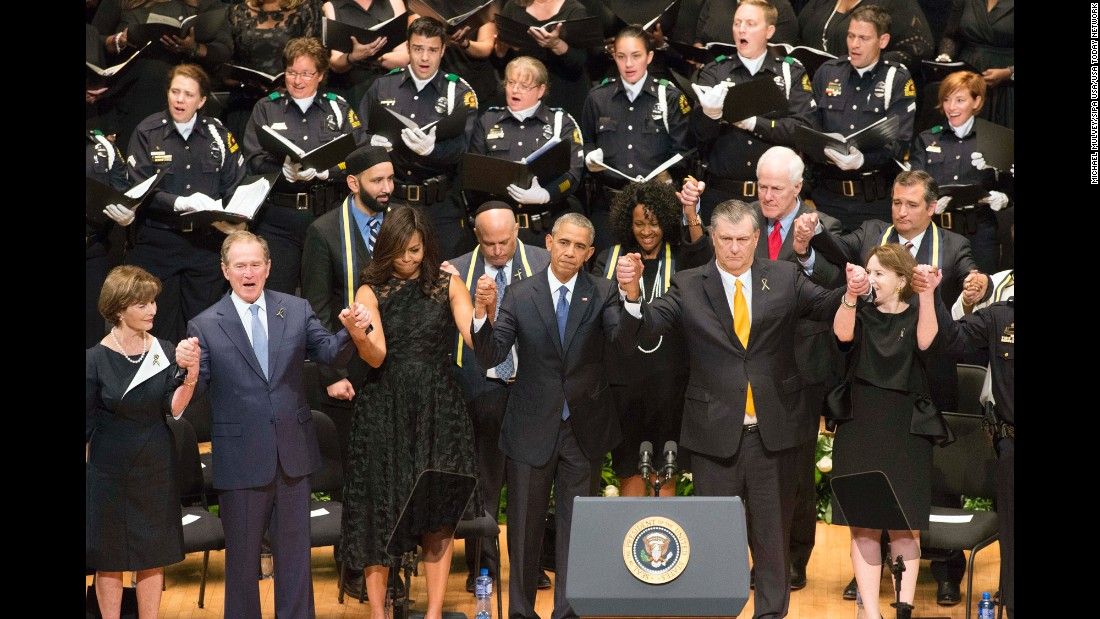 "U.S. first lady Michelle Obama and President Barack Obama, with, from left, former first lady Laura Bush, former President George W. Bush,  Dallas Mayor Mike Rawlings and his wife, Micki Rawlings, at an interfaith memorial service in Dallas on Tuesday, July 12, after the <a href=""http://www.cnn.com/2016/07/08/us/philando-castile-alton-sterling-protests/index.html"" target=""_blank"">killings of five police officers</a> during an anti-police brutality protest in the city just days before."