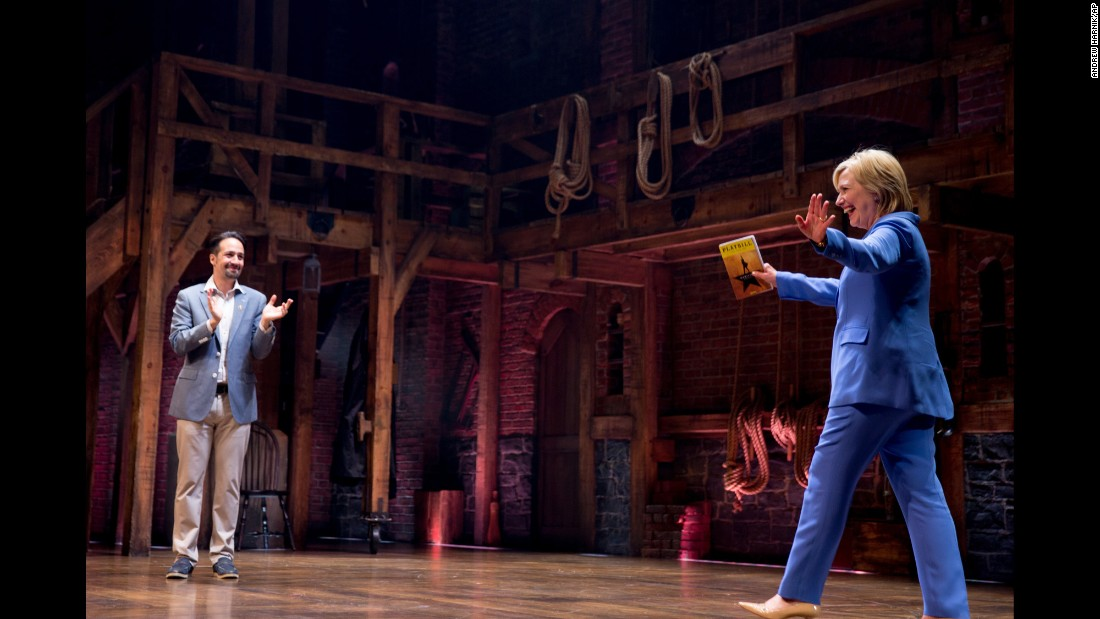 """Hamilton"" creator Lin-Manuel Miranda applauds as Democratic presidential candidate Hillary Clinton makes an appearance at the Richard Rodgers Theatre in New York on Tuesday, July 12. The cast of the Broadway smash hit <a href=""http://www.cnn.com/2016/06/25/politics/hillary-clinton-hamilton-performance/"" target=""_blank"">performed an extra show as part of a joint fundraiser</a> for Clinton's campaign and the Democratic National Committee."