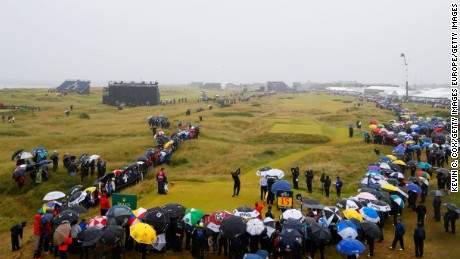 Troon endured spells of heavy rain and gusty wind amid clearer patches on Friday.