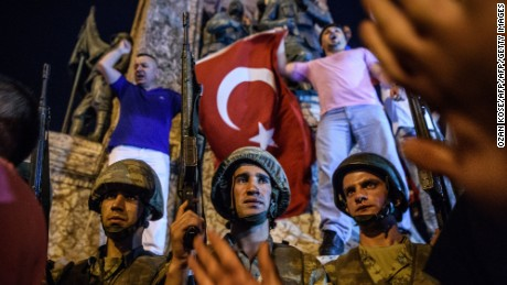 Turkish solders stay at Taksim square as people react in Istanbul on July 16, 2016.  Turkish military forces on July 16 opened fire on crowds gathered in Istanbul following a coup attempt, causing casualties, an AFP photographer said. The soldiers opened fire on grounds around the first bridge across the Bosphorus dividing Europe and Asia, said the photographer, who saw wounded people being taken to ambulances.   / AFP / OZAN KOSE        (Photo credit should read OZAN KOSE/AFP/Getty Images)