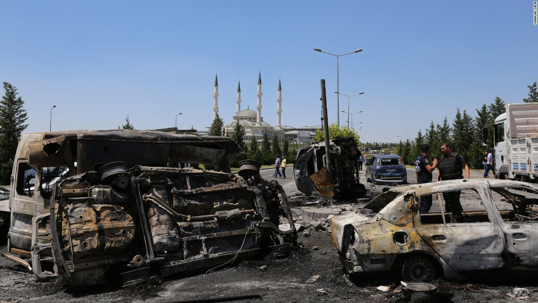Damaged vehicles are abundant outside the presidential palace in Ankara on July 16.
