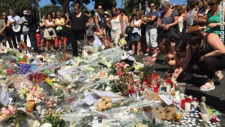 People left flowers, candles and other tributes in Nice, France, on Saturday in memory of those killed in Thursday's terror attack in the coastal city.