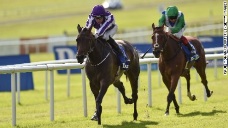 Seventh Heaven, left, with Seamie Heffernan up, pulls clear of Architecture, ridden by Frankie Dettori, to win the Irish Oaks at the Curragh.