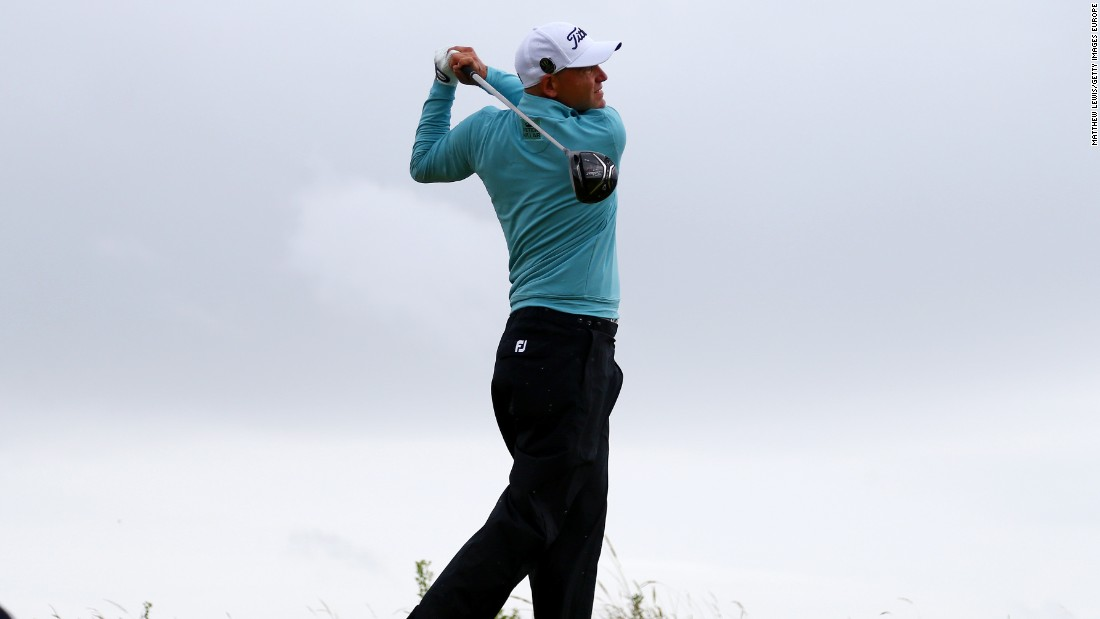 Bill Haas of the United States hits his tee shot on the 13th as he chased the leaders on six-under.