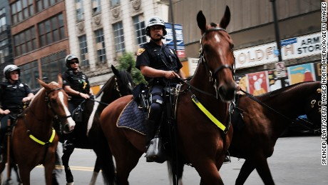 CLEVELAND, OH - JULY 16:  Security personnel on horseback ride through downtown Cleveland on July 16, 2016 in Cleveland, Ohio. An estimated 50,000 people are expected in Cleveland, including hundreds of protesters and members of the media. The four-day Republican National Convention kicks off on July 18.  (Photo by Spencer Platt/Getty Images)