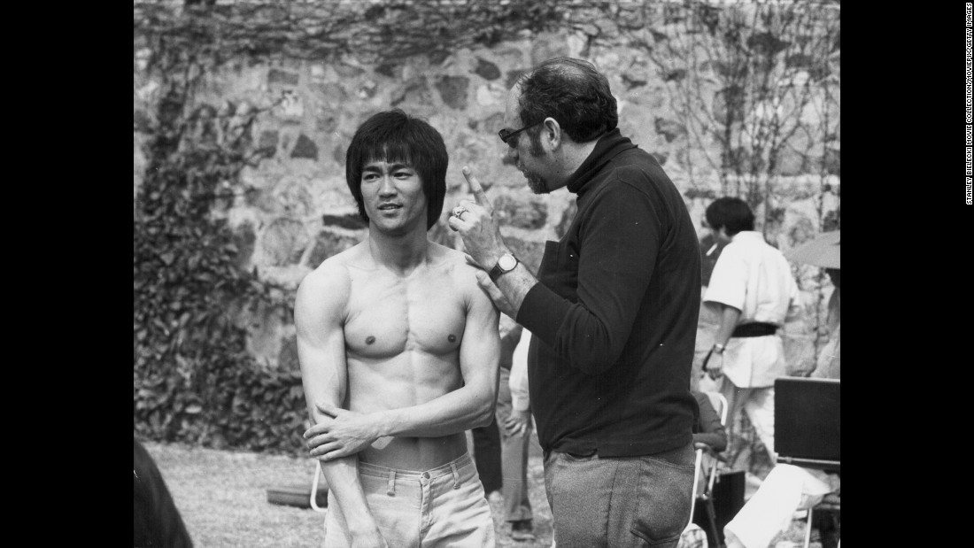 "Bruce Lee with producer Fred Weintraub, on the set of the movie ""Enter the Dragon,"" 1973. The movie was his first Hollywood movie and reports said he knew it would be a huge hit even before it came out."