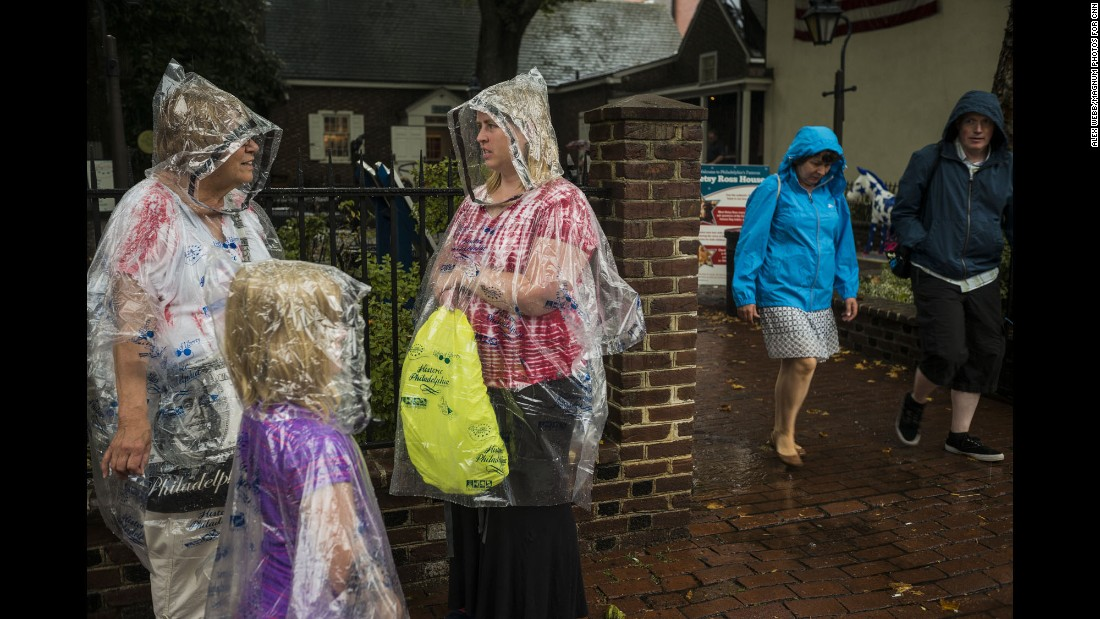 Tourists congregate outside the Betsy Ross House, where the iconic seamstress is said to have lived when she sewed the first American flag.