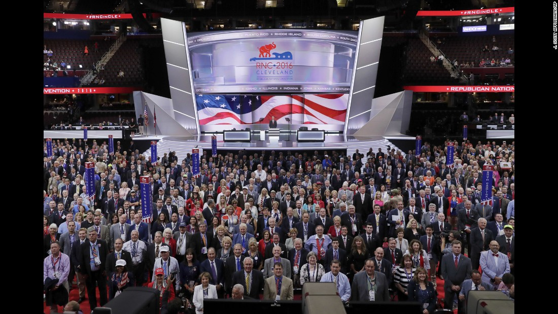 Delegates stand and turn toward the camera for an official photo on Monday.