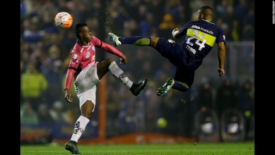 Boca Juniors soccer player Frank Fabra, right, battles for the ball with Jose Angulo of Independiente del Valle on Thursday, July 14. Independiente won the match in Buenos Aires and clinched a spot in the final of Copa Libertadores, the premier club competition in South America. The Ecuadorian club will face Colombian club Atletico Nacional in the finals.