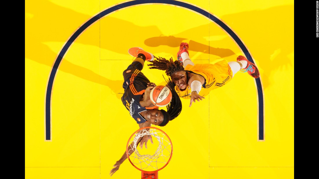 Connecticut's Chiney Ogwumike pulls down a rebound in front of Indiana's Eriana Larkins during a WNBA game in Indianapolis on Wednesday, July 13.