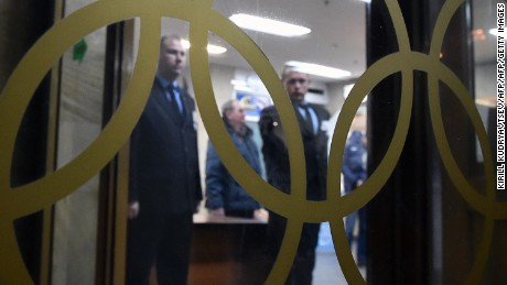 Security guards are seen through the glass window displaying the Olympic Rings at the Russian Olympic Committee building in Moscow on November 18, 2015. AFP PHOTO / KIRILL KUDRYAVTSEV        (Photo credit should read KIRILL KUDRYAVTSEV/AFP/Getty Images)