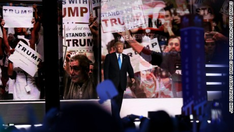 CLEVELAND, OH - JULY 18:  Presumptive Republican presidential nominee Donald Trump walks on stage to introduce his wife Melania on the first day of the Republican National Convention on July 18, 2016 at the Quicken Loans Arena in Cleveland, Ohio. An estimated 50,000 people are expected in Cleveland, including hundreds of protesters and members of the media. The four-day Republican National Convention kicks off on July 18.  (Photo by John Moore/Getty Images)