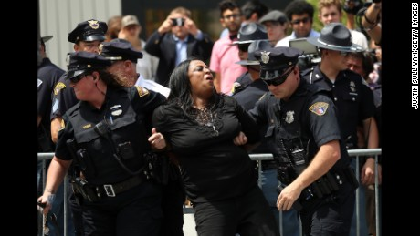 CLEVELAND, OH - JULY 18:  Cleveland police officers detain a protester in Cleveland Public Square near the site of the Republican National Convention on July 18, 2016 in Cleveland, Ohio. Protestors are staging demonstrations outside of the Republican National Convention which starts on Monday July 18 and runs through July 21.  (Photo by Justin Sullivan/Getty Images)