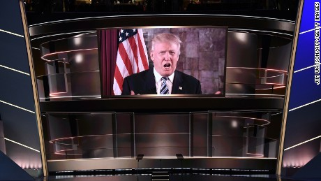 Republican presidential candidate Donald Trump speaks on screen during the second day of the Republican National Convention at the Quicken Loans Arena in Cleveland on July 19, 2016.