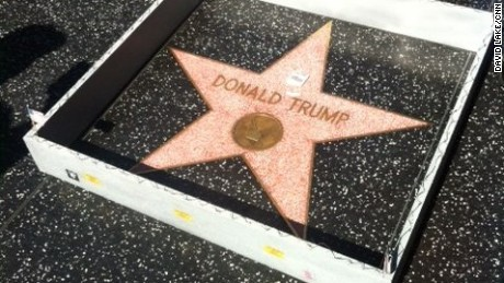 A tiny cement wall has appeared around Donald Trump's star on the Hollywood Walk of Fame, complete with barbed wire at the top and tiny American flags on the corners.