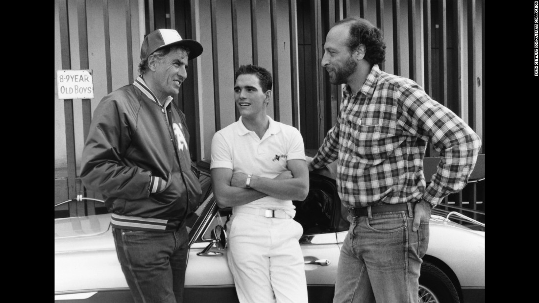 "Marshall, left, talks with actor Matt Dillon, center, and producer Michael Phillips between takes of ""The Flamingo Kid"" in 1984."