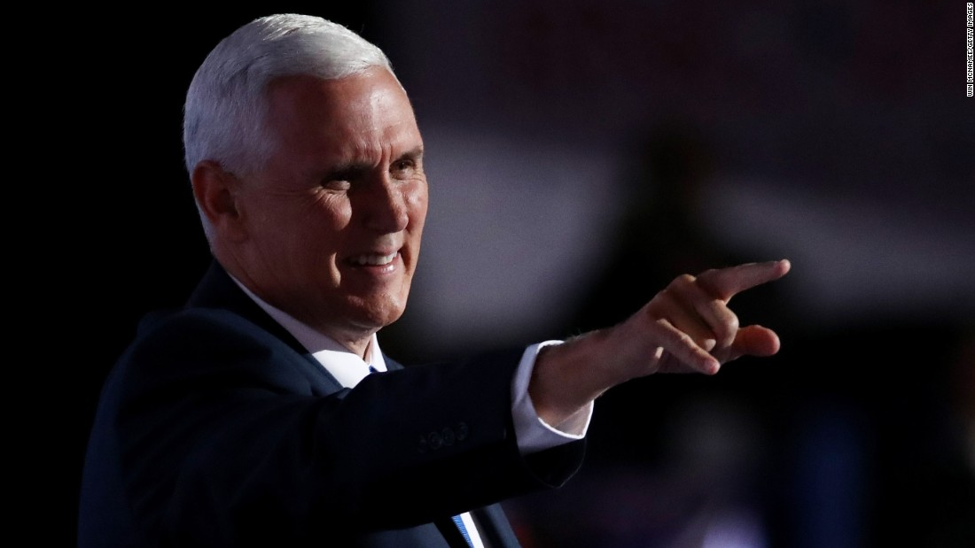 Pence points to the crowd as he walks on stage to deliver a speech on the third day of the Republican National Convention on July 20, 2016, at the Quicken Loans Arena in Cleveland, Ohio.