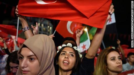 "Pro Erdogan supporters hold Turkish national flags during a rally at Taksim square i istanbull on July 20, 2016 following the failed military coup attempt of July 15. Turkish President Recep Tayyip Erdogan on July 20, 2016 vowed that democracy would not be compromised in Turkey despite declaring a three month state of emergency in the wake of a coup. ""We have never made compromises on democracy. And we will never make"" them, Erdogan told a news conference in Ankara.  / AFP / DANIEL MIHAILESCU        (Photo credit should read DANIEL MIHAILESCU/AFP/Getty Images)"