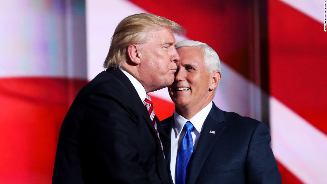 "Trump gives an ""air kiss"" to Pence after Pence's speech."