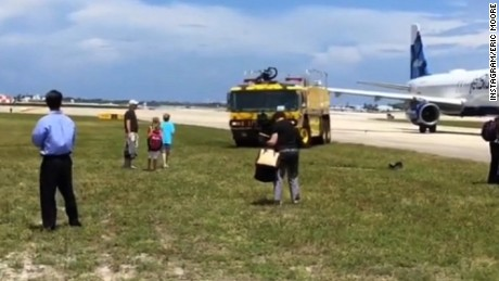 Passenger aboard an American Airlines plane captured video of their flight as it was evacuated at Palm Beach International airport in Florida.