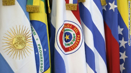 The Paraguayan flag is seen next to other members of the Mercosur during the XLIII Mercosur presidential summit in Mendoza, 1050 Km west of Buenos Aires, Argentina on June 29, 2012. AFP PHOTO / Juan Mabromata        (Photo credit should read JUAN MABROMATA/AFP/GettyImages)