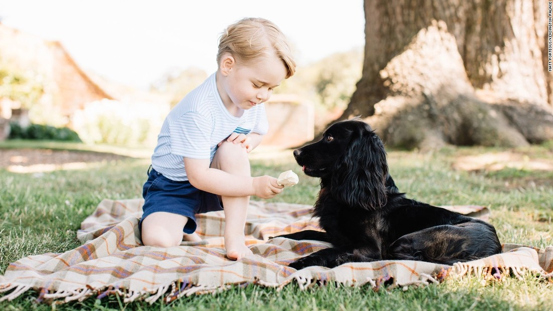 The Duke and Duchess of Cambridge released new photos of Prince George to mark his third birthday on July 22, including this one of the young prince and the family's pet dog Lupo.