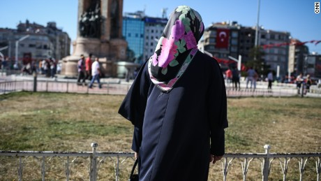 Serap, a housewife, poses for a photo in Taksim Square, in Istanbul.