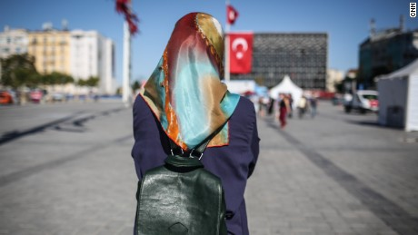 Nurgul, a Kurdish waitress, poses for a photo in Taksim Square, in Istanbul.