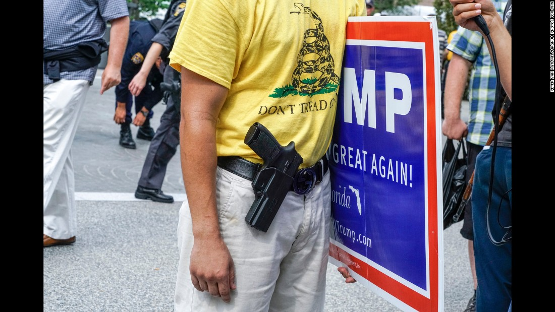 "A gun is seen <a href=""http://www.cnn.com/2016/07/20/politics/gallery/outside-rnc-van-agtmael/index.html"" target=""_blank"">outside the Republican National Convention.</a> ""Open carry"" gun laws allow Ohio's licensed firearm owners to wear their weapons in public."