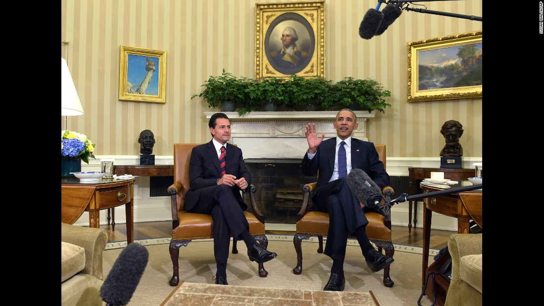 "U.S. President Barack Obama, right, meets with Mexican President Enrique Pena Nieto in the White House Oval Office on Friday, July 22. The two <a href=""http://www.cnn.com/2016/07/22/politics/obama-trump-mexican-president-pena-nieto-visit/"" target=""_blank"">met for talks</a> about trade, climate change and how to counter drug trafficking."